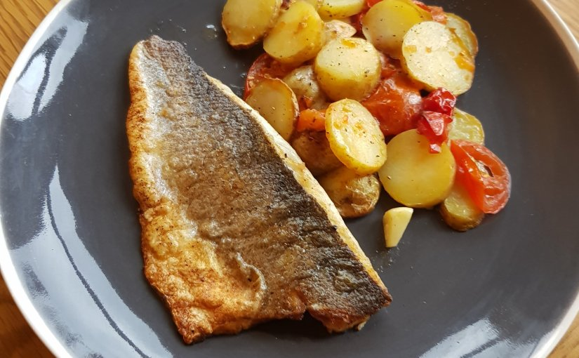 Sea bass with potato and tomatobake