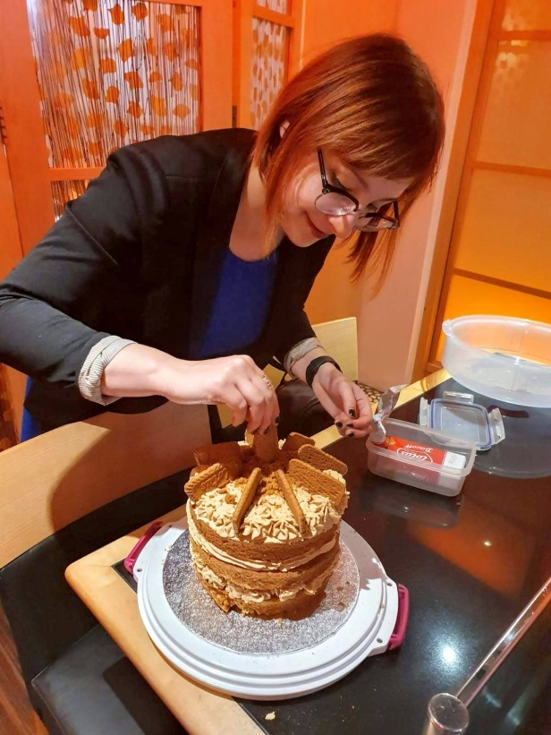Final touches on the Biscoff cake