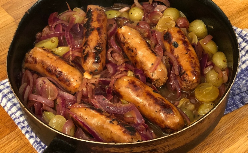 Rachel Roddy's Sausages with red onions and grapes
